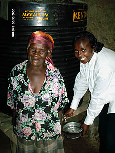Monicah with water tank recipient